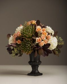 A soft pairing of burgundy, sage, and blush using premium roses, succulents, starburst mums and seasonal foliage. Floral by freshdesign http://freshdesignflowers.com