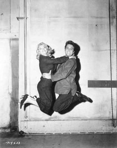 This photo shows Jennifer Holden and Elvis Presley goofing around on the set of Jailhouse Rock (MGM) in Culver City, CA - circa May 1957. Elvis did a bunch of PR shots for his third movie on Friday, May 31, 1957, and this may be the date of this photo. Jennifer Holden (born October 24, 1936) played Sheree Wilson, Vince Everett's (Elvis') reluctant date in the movie. Jailhouse Rock premiered on October 17, 1957 in Memphis, TN and was released nationwide on November 8, 1957.