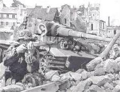 German sniper taking aim beside a Tiger1