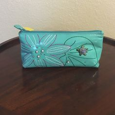 Brighton turquoise cosmetic bag. Brighton turquoise cosmetic bag. This bag is new but has some ink stains in back as shown. Brighton Bags Cosmetic Bags & Cases