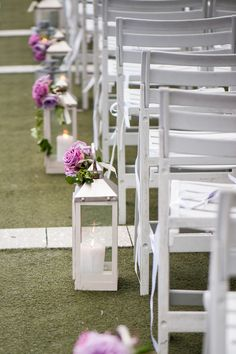 Silver lanterns lit with candles lined the aisles and were decorated with single stems of roses. Silver Lanterns, Wedding Lanterns, Lanterns Decor, Wedding Ceremony Backdrop, Ceremony Decorations, Floral Decorations, Wedding Ceremonies, Wedding Events, Bridesmaid Flowers