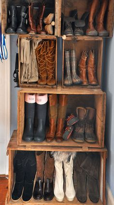 Vintage apple crates as shoe shelves at Tata Harper's farm via Clos-ette