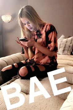 Khloe Kardashian wearing Good American Good Legs Black003 Raw Edge Hem Destroyed Skinny Jeans and V2bentley Custom Harley Davidson Tee