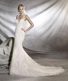 Pronovias Orlara beautiful lace fit and flare bridal gown with an illusion back. Please contact either store for pricing and appointment details.