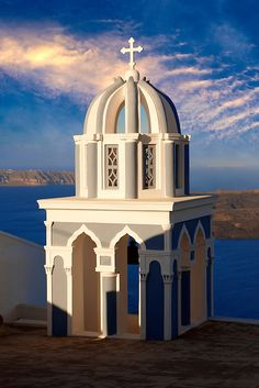 Bell tower of Orthodox church in Fira - Santorini, Greece