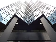 architecture structure glass perspective roof building urban downtown ceiling geometric corporate office facade professional business modern futuristic interior design design windows symmetry headquarters daylighting