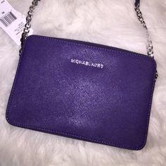 NWT Purple Michael Kors Jet Set Crossbody Brand new and never used.... In pristine condition. Authentic Michael Kors purple Jet Set Crossbody purse with silver chain and leather adjustable strap. Tags are still attached ($148) and strap in protective wrapping. MICHAEL Michael Kors Bags Crossbody Bags