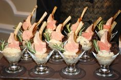 Class in a glass! Grilled lollipop lamb chops served with rosemary mashed potatoes in a mini martini glass! Call Jacques Catering for more details (732) 495-2600