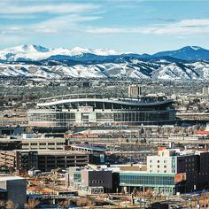 Sports Authority Field at Mile High stacks up against the foothills as the last of the snow in Denver melts away... : @sty_____