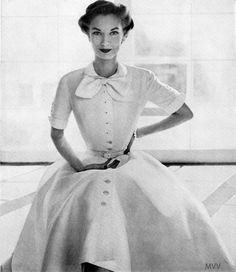 Vogue January 1952////  For those of you who were no where near living in the 50's, I just want to say that many, many mothers cleaned house, washed clothes, and whatever else needed doing while wearing this!  Oh, and they didn't get dirty.