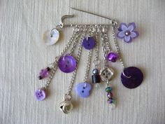Button jewelry - silvertone  brooch ,kilt pin -  silver & purple  button , beads and bells