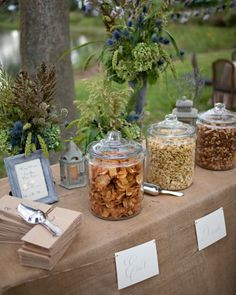 Salty Snacks Before guests arrived at the ceremony, pre-ceremony snacks like Old Bay-seasoned potato chips, spiced nuts, and dilled oyster crackers were set out on a table with paper bags and scoops so guests could help themselves. Wedding Snack Bar, Wedding Reception Food, Wedding Ideas, Wedding Rehearsal, Mesas De Snack Ideas, Bar A Bonbon, Oyster Crackers, Spiced Nuts, Food Stations