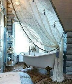 Cozy Attic Clawfoot Tub And Lace Divider