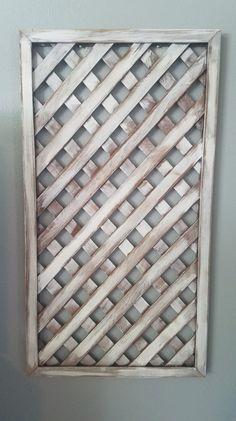 Using salvaged garden lattic panels for indoor wall decor!