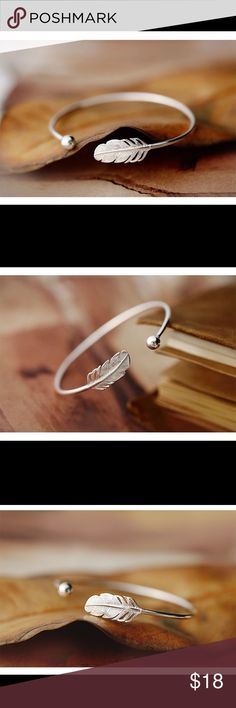 "STERLING SILVER PLATINUM PLATED FEATHER BANGLE  This is a Sterling Silver (925) Platinum Plated Feather Bangle. It is a dainty piece and would pair great with with the Feather earring I my closet. It's a matching set to the Feather ring in my closet. This measures: from the outside to the outside of the bangle is: 2 5/16 ""L. From the inside of the bangle it is: 2 1/4""L. The Leaf is 1""L X 3/8""W. Jewelry Bracelets"
