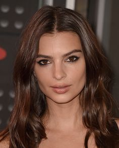 Low-key can look lazy on the red carpet, but Emily Ratajkowski's center-parted waves and smudged black liner felt right, like she was letting the nominees shine.   - ELLE.com