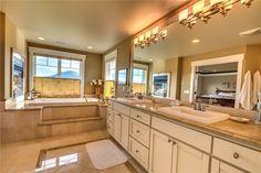 Traditional Master Bathroom with Legacy Bone, Glazed Rectified Porcelain, Stone Tile, Clayton 4 Light Bathroom Vanity Light