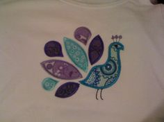 peacock applique idea - would be nice crocheted on a deep purple hat.