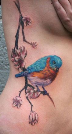 What does bluebird tattoo mean? We have bluebird tattoo ideas, designs, symbolism and we explain the meaning behind the tattoo. Body Art Tattoos, Small Tattoos, Cool Tattoos, Bird Tattoos, Tattoo Art, Tatoos, Herren Hand Tattoos, Bluebird Tattoo, Skull Hand Tattoo