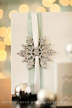 Christmas Wrapping with Silver Snowflake - 15 Breathtaking DIY Christmas Gift Wrapping Ideas | GleamItUp