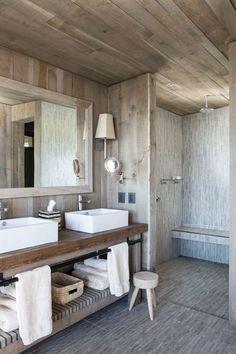 Coastal bathroom with clean, open storage under the sinks