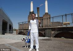 Michael Owen carried the Olympic Torch through Battersea dogs home with a Staffordshire Bull Terrier called Rory as part of the relay around Britain