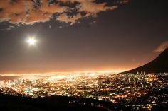 sun over an ocean of city-lights