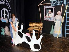 """Hannah Miller drags an upside-down cow across the stage while Megan Mullen and Reagan Maginn look on during a rehearsal for the Madison Consolidated High School Theatre production of  """"Fools."""" (Staff photo by Ken Ritchie)"""