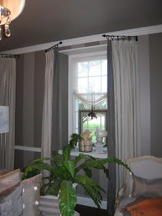 Swing arm rods.. so you can open up the room for full light from your windows! (link includes close-up of rods)