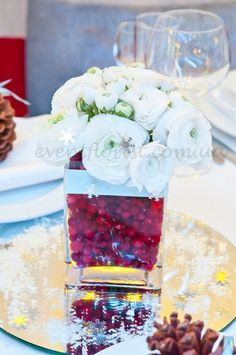 winter wedding centerpiece with cranberry- filler. Baby's breath or branches with votives