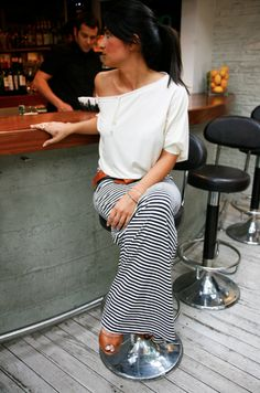 Love the striped maxi skirt and over-sized t-shirt combo with a thick leather belt to pull it all together. Perfect for a summer night at a casual bar.