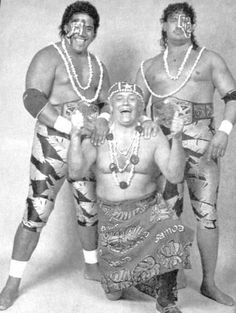 The Samoan Swat Team (Fatu & Samu) with their manager Buddy Roberts and the World Class Championship Wrestling Tag Team belts.