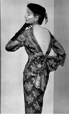 1953 Model in exquisite two-tone lace two-piece, the top has high neckline that plunges in the back and ties in large bow, by Jacques Fath
