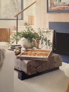 Coffee table made of old beams, black wood block