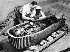 Howard Carter opens the innermost shrine of King Tutankhamen's tomb near Luxor Egypt.