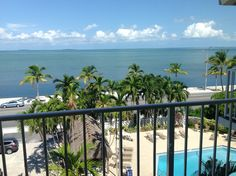 Balcony view from Bayside Inn & Suites Key West. Stayed here.had a beautiful huge room that stretched from one end of the hotel to another with a pool view (and at a reasonable price! Key West Hotels, Balcony, Lazy, Keys, Spaces, Future, Beach, Water, Plants