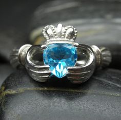This is blue topaz, but I want a blue diamond claddagh ring to wear in front of my engagement ring!