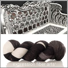 Expression Fiber Arts DISTRESSED BENCH Superwash Resilient Sock Yarn! A photo I snapped at a local garden! A delightful mix of soft black (in some lights it appears to be a brown/gray black) that fades to subtlest cream.