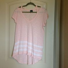Anthropologie hi lo tee Never worn peachy pink tee by Anthropologie Left of Center. Three white stripes at bottom. Open at shoulders. 100% cotton. There is a small hole on front that could easily be fixed. Priced accordingly. Anthropologie Tops Tees - Short Sleeve