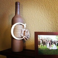 Easy DIY wine bottle craft. All I did was paint a bottle with acrylic paint, wrap the middle with burlap. Bought the pre-made burlap bow and letter C at Michael's, and hot-glued them on! Done :) the whole thing was under $10. #paintedwinebottles