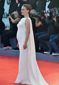 Natalie Portman pregnant: actress shows off surprsie baby bump on the red carpet