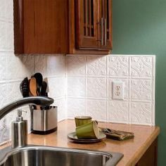 Grant a distinct classical appearance to your kitchen or bathroom in home with this Fasade Matte White Traditional Style # 1 PVC Decorative Backsplash Panel. Adhesive Tile Backsplash, Backsplash Panels, Kitchen Backsplash, Kitchen Cabinets, Floors Kitchen, Dark Cabinets, Cupboards, Decorative Wall Panels, Decorative Shelf