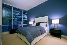 http://www.justsoakit.com/wp-content/uploads/2015/02/beautiful-color-of-the-walls-interior-bedroom-with-blue-painting-wall-and-glass-window-plus-duvet-cover-as-well-lamps-desk-the-bedisde-870x581.jpg
