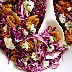 Red Cabbage Salad with Blue Cheese and Maple-Glazed Walnuts | This hearty salad recipe —combining red cabbage, blue cheese and glazed walnuts, is the perfect, low-calorie accompaniment to roast pork or chicken.