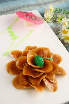 Hangzhou's culinary delight: soy-preserved radish in the shape of flower.  #travelogue #travel #Hangzhou #beautiful #scenary #photography  #gorgeous #romantic #urbanlife #urbanite #city #citylife #nature