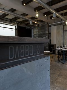 Dabbous restaurant and bar, located in the heart of London's West End. Spread over two levels, the restaurant and bar has an industrial feel with exposed Commercial Design, Commercial Interiors, Cafe Restaurant, Restaurant Design, Modern Restaurant, Bar Metal, Metal Grid, Concrete Materials, Concrete Wood