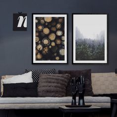 Dark interior design with gray walls and framed posters with wood and forest motifs from printler.com, the marketplace for photo art. Motifs by Karl Johansson and @rowantree_