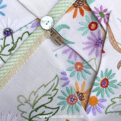 Loving vintage embroidered linens at the moment. A busy day finally making them into colourful flag bunting for our shop!  #colourfulbunting #flowerybunting #floralbunting #embroideredflowers #embroideredflorals #vintageembroidery #vintagelinen