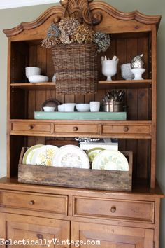 Gorgeous fall home tour - love the hanging basket over shelves or dining hutch eclecticallyvintage.com #EclecticallyFall