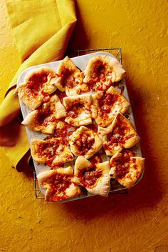 "Instead of ordering pizza, serve these poppable pizza cups. They're one of our best football game snacks because unlike with a delivery pie, you're not stuck with just one topping combo—each muffin tin ""slice"" can be customized to fit guests' preferences. #superbowlrecipes #appetizers #tailgaterecipes #fingerfoods #apps #bhg Bhg Recipes, Fun Easy Recipes, Easy Meals, Cooking Recipes, Family Recipes, Pizza Recipes, Pizza Cups, Pizza Bites, How To Make Pizza"